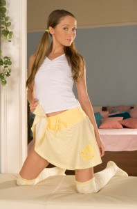 Princess Molly in a cute yellow skirt and white top, ponytails on the sides of head. 800 601 7259
